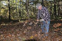 NWA Democrat-Gazette/FLIP PUTTHOFF <br /> Ken French of the Lake Wedington area removes old fencing Oct. 21 2016 during a Northwest Arkansas Master Naturalists work session at Sweden Creek Falls Natural Area.