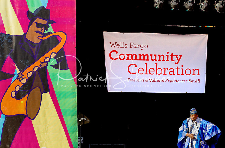 A colorfully dressed singer performs during the Wells Fargo Community Celebration, held October 29, 2011 in downtown Charlotte NC. The daylong festival took place in the streets, in public atriums and in downtown museums, which offered free admission all day long. Wells Fargo, which this month completed its conversion from Wachovia, picked up the bill.
