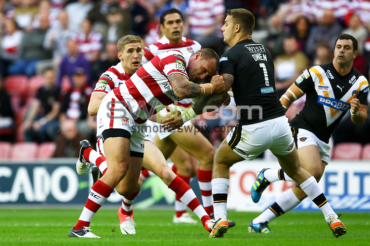 PICTURE BY ALEX WHITEHEAD/SWPIX.COM - Rugby League - Super League - Wigan Warriors v Castleford Tigers - DW Stadium, Wigan, England - 27/07/12 - Wigan's Gareth Hock is tackled by Castleford's Richard Owen.