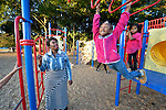 Casual Tabron plays with her daughter, named Sunday, in a park in Raleigh, North Carolina. Ms. Tabron, who works several jobs, receives some assistance from Urban Ministries of Wake County, which is supported by Church World Service.