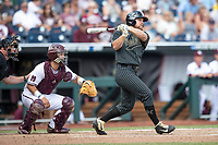 Vanderbilt Commodores outfielder Stephen Scott (19) follows through on his swing during Game 8 of the NCAA College World Series against the Mississippi State Bulldogs on June 19, 2019 at TD Ameritrade Park in Omaha, Nebraska. Vanderbilt defeated Mississippi State 6-3. (Andrew Woolley/Four Seam Images)