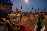 Italian soldiers from the  Fifth  Lancieri of Novara regiment of the Italian Cavalry execute a flag ceremony that defines the end of the day's activities  in the UNIFIL Chama base in Southern Lebanon on Friday Dec 08 2006..Close to 1000 Italian peacekeepers operate in  the in Southern lebanon town of Chama, constantly patrolling their sector in search for illegal weapons in the country.