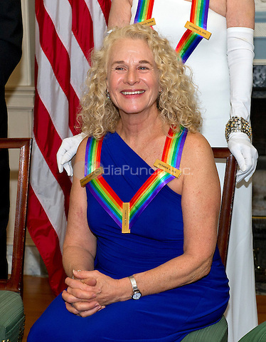 Singer-songwriter Carole King, one of the five recipients of the 38th Annual Kennedy Center Honors, poses as part of a group photo following a dinner hosted by United States Secretary of State John F. Kerry in their honor at the U.S. Department of State in Washington, D.C. on Saturday, December 5, 2015.  The 2015 honorees are: singer-songwriter Carole King, filmmaker George Lucas, actress and singer Rita Moreno, conductor Seiji Ozawa, and actress and Broadway star Cicely Tyson.<br /> Credit: Ron Sachs / Pool via CNP/MediaPunch