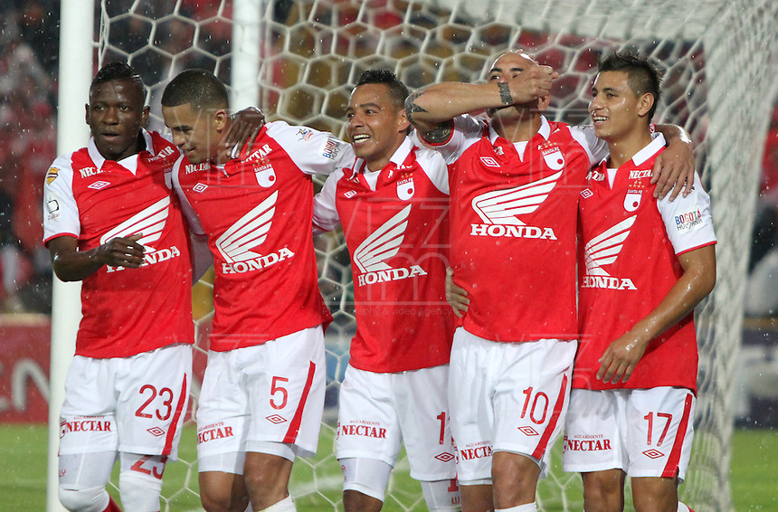 fBOGOTA - COLOMBIA- 05 -05-2013: Omar Pérez ( 4 de izq a der)  jugador de  Santa Fe  celebra su gol  contra  Chicó    partido en el estadio El Campín de la ciudad de Bogotá, mayo 11  de 2013. partido por la  fecha  quince   de la Liga Postobon I. (Foto: VizzorImage / Felipe Caicedo / Staff). Player Omar Pérez Santa Fe celebrates his goal against Chico match at El Campin in Bogota, May 11, 2013. party by the fifteenth day of the League Europa League I. .  (Foto: VizzorImage / Felipe Caicedo / Staff).