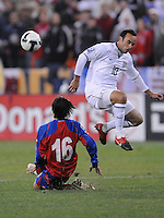 Costa Rica defender Cristian Montero (16) slides to defend the play against USMNT midfielder Landon Donovan (10)  The USMNT tied Costa Rica 2-2 on the final game of the 2010  FIFA World Cup Qualifying round at RFK Stadium,Wednesday  October 14 , 2009.