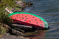 For decades, a stone semicircle on the shore next to a busy roadway has been painted to resemble a slice of watermelon.  Painted, and repainted, and painted again, becoming a local landmark.