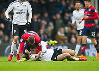 QPR Joel Lynch and Fulham's Aleksandar Mitrovic clash during the Sky Bet Championship match between Fulham and Queens Park Rangers at Craven Cottage, London, England on 17 March 2018. Photo by Andrew Aleksiejczuk / PRiME Media Images.