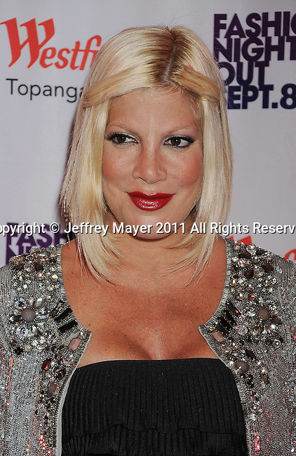 CANOGA PARK, CA - SEPTEMBER 08: Tori Spelling arrives at the Westfield Topanga's Fashion Night Out 2011 held  at the Westfield Topanga Mall on September 8, 2011 in Canoga Park, California.