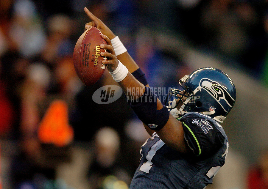 Nov. 27, 2005; Seattle, Wash, USA;  Seattle Seahawks running back #37 Shaun Alexander celebrates after scoring a touchdown against the New York Giants in the fourth quarter at Qwest Field. Mandatory Credit: Photo By Mark J. Rebilas