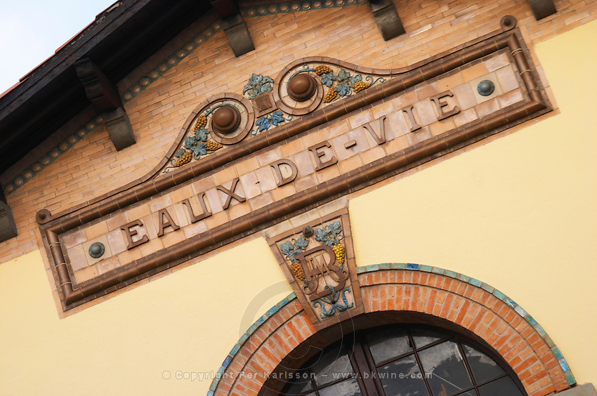 Ceramic sign saying Eaux de Vie at the old distillery. Town of Limoux. Limoux. Languedoc. France. Europe.