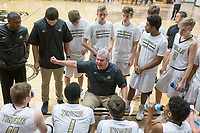 NWA Democrat-Gazette/CHARLIE KAIJO Bentonville High School head coach Dick Rippee talks to his team during a basketball game on Friday, January 12, 2018 at Bentonville High School in Bentonville.