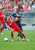 August 21 2010 New York Red Bulls forward Thierry Henry #14 battles with Toronto FC defender Adrian Cann #12 during a game between the New York Red Bulls and Toronto FC at BMO Field in Toronto..The New York Red Bulls won 4-1