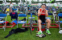 13 JUN 2010 - BEAUVAIS, FRA - A competitor during the Beauvais Triathlon prepares in transition for the run.(PHOTO (C) NIGEL FARROW)