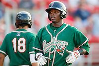 Rand Smith #21 of the Greensboro Grasshoppers returns to the dugout after hitting a solo home run in the top of the 11th inning against the Hickory Crawdads at  L.P. Frans Stadium July 10, 2010, in Hickory, North Carolina.  Photo by Brian Westerholt / Four Seam Images