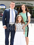 Mia Donskyte who received first holy communion in St Peters church West street pictured with her parents Gvidas and Ramona. Photo:Colin Bell/pressphotos.ie