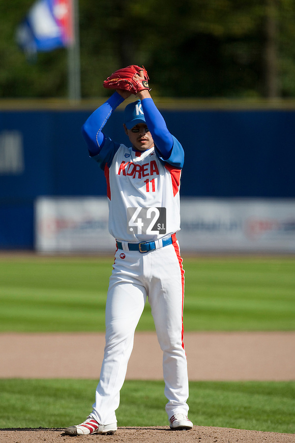 14 September 2009: Hee-Girl Kim of South Korea pitches against Great Britain during the 2009 Baseball World Cup Group F second round match game won 15-5 by South Korea over Great Britain, in the Dutch city of Amsterdan, Netherlands.
