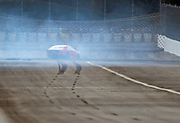 Feb 11, 2017; Pomona, CA, USA; Skidmarks are visible as NHRA pro stock driver Tom Huggins attempts to slow down after his parachutes failed to deploy before going into the sand trap during qualifying for the Winternationals at Auto Club Raceway at Pomona. Mandatory Credit: Mark J. Rebilas-USA TODAY Sports