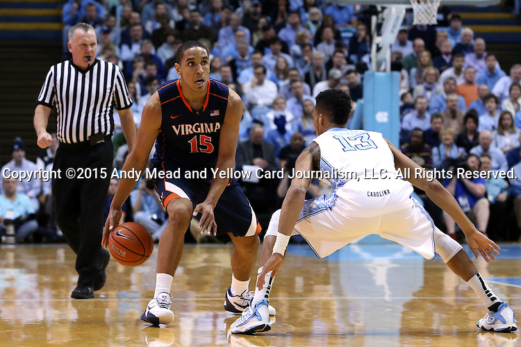 02 February 2015: Virginia's Malcolm Brogdon (15) and North Carolina's J.P. Tokoto (13). The University of North Carolina Tar Heels played the University of Virginia Cavaliers in an NCAA Division I Men's basketball game at the Dean E. Smith Center in Chapel Hill, North Carolina. Virginia won the game 75-64.