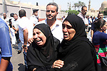 Egyptians attend the funeral of the policemen who were killed during clashes with supporters of ousted Egyptian President Mohamed Morsi in Cairo, Egypt, 15 August 2013. Egyptian government has said that 522 people were killed in the country on 14 August in violence linked to the police's break-up of major protest camps by Islamists in Cairo. Spokesman Mohammed Fatallah said that the figure included 289 killed in the crackdown on the two pro-Morsi protest vigils in the north-east and south of the capital. Photo by Ahmed Asad