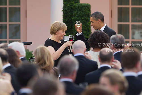 "United States President Barack Obama toasts with Angela Merkel, Germany's chancellor, during a State Dinner at the White House in Washington, D.C., U.S., on Tuesday, June 7, 2011. Obama said he and Merkel agreed that the debt crisis in Europe ""cannot be allowed to put the global economic recovery at risk."" .Credit: Andrew Harrer / Pool via CNP"