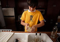 montreal  (QC) CANADA - Sept  2009 - model released photo of an asian teenage male washing dishes