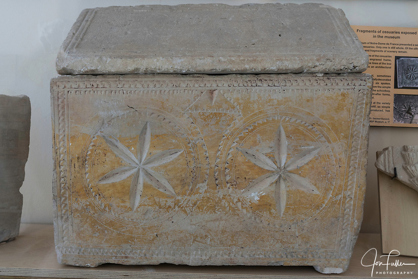 A Jewish-era ossuary in the museum at the Church of St. Peter in Gallicantu.  Ossuaries were used to hold the remains of skeletons when space in a tomb was needed for a later burial.  Men's ossuaries had a rounded dome lid, while female ossuaries, such as this one, had a triangular lid.