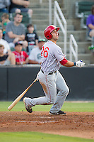 Carlos Lopez (26) of the Hagerstown Suns follows through on his swing against the Kannapolis Intimidators at CMC-Northeast Stadium on May 31, 2014 in Kannapolis, North Carolina.  The Intimidators defeated the Suns 4-3 in game two of a double-header.  (Brian Westerholt/Four Seam Images)