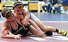 Nick Karamoshos of Massapequa, top, battles Joseph Russo of Wantagh at 126 pounds during the Nassau County Divsision I varsity wrestling quarterfinals at Hofstra University on Saturday, Feb. 11, 2017. Karamoshos won the match by decision 5-2.