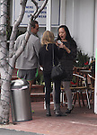 ..March 28th 2012...Amanda Seyfried shopping at Fred Segal with some friends  off Melrose ave in west Hollywood. An asian fan took a picture with Amanda . black leather purse handbag old army boots holding coffee ..AbilityFilms@yahoo.com.805-427-3519.www.AbilityFilms.com..
