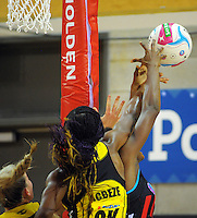 Ama Agbeze and Mwai Kumwenda reach for a rebound during the ANZ Netball Championship match between the Central Pulse and Mainland Tactix at Te Rauparaha Arena, Wellington, New Zealand on Saturday, 11 May 2015. Photo: Dave Lintott / lintottphoto.co.nz