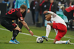 30.11.2019, RheinEnergieStadion, Koeln, GER, 1. FBL, 1.FC Koeln vs. FC Augsburg,<br />  <br /> DFL regulations prohibit any use of photographs as image sequences and/or quasi-video<br /> <br /> im Bild / picture shows: <br /> Ismail Jakobs (FC Koeln #38), im Zweikampf gegen  André Hahn (FC Augsburg #28),  <br /> <br /> Foto © nordphoto / Meuter
