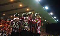 Lincoln City's Mark O'Hara, third in from left, celebrates scoring the opening goal with team-mates Harry Anderson, Neal Eardley, and Danny Rowe<br /> <br /> Photographer Chris Vaughan/CameraSport<br /> <br /> The EFL Sky Bet League Two - Lincoln City v Yeovil Town - Friday 8th March 2019 - Sincil Bank - Lincoln<br /> <br /> World Copyright © 2019 CameraSport. All rights reserved. 43 Linden Ave. Countesthorpe. Leicester. England. LE8 5PG - Tel: +44 (0) 116 277 4147 - admin@camerasport.com - www.camerasport.com