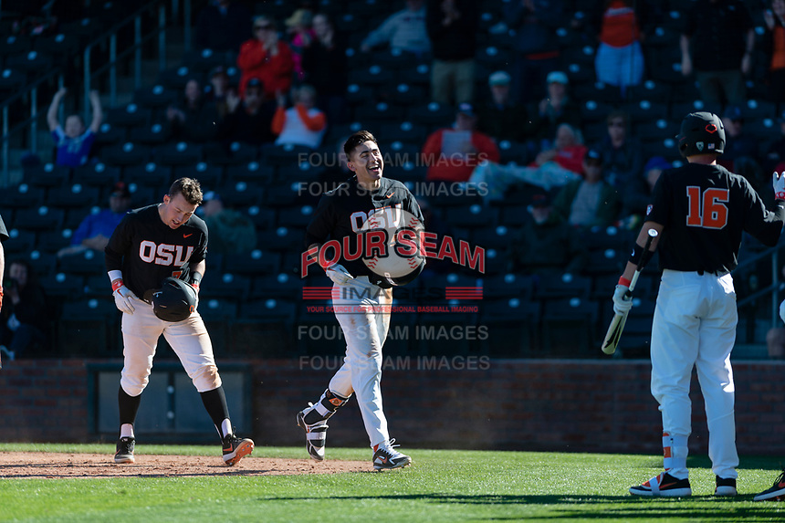 Oregon State Beavers shortstop Beau Philip (4) is congratulated by teammates after hitting a three-run home run during a game against the Gonzaga Bulldogs on February 16, 2019 at Surprise Stadium in Surprise, Arizona. Oregon State defeated Gonzaga 9-3. (Zachary Lucy/Four Seam Images)