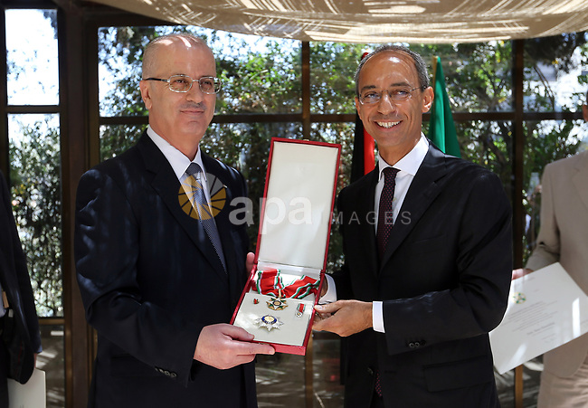 "Palestinian Prime Minister Rami Hamdallah receives ""The Order of the Star of Italy"" from the Italian Consul General Fabio Sokolovic, in the West Bank city of Ramallah on June 21, 2018. Photo by Prime Minister Office"