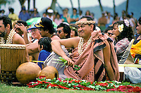 Historic photo of a younger Robert Cazimero as he waits for his performance with his halau at a hula festival on Oahu.