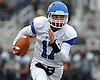 Port Washington quarterback No. 17 Drew Reiter runs the ball during a Nassau County Conference I varsity football game against host Plainview JFK High School on Saturday, October 3, 2015. Plainview JFK won by a score of 42-0.<br /> <br /> James Escher