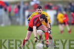 Tarberts Kieran Deenihan(9) beats Denis Walsh(19) of Listowel Emmets to the ball in the North Kerry Senior Football Final held last Sunday in Bob Stack Park, Ballybunion.