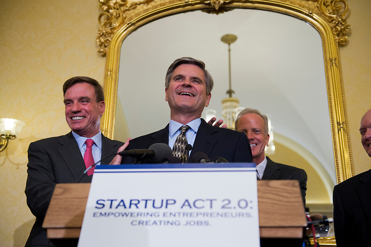UNITED STATES - MAY 22:  From left, Sens. Mark Warner, D-Va., Steve Case, co-founder of AOL, Sens. Jerry Moran, R-Kan., and Sen. Chris Coons, D-Del., conduct a news conference in the Capitol on the Startup Act 2.0, which aims to boost investment in smaller, startup companies through tax incentives and also would encourage American-educated people remain in the country.  (Photo By Tom Williams/CQ Roll Call)