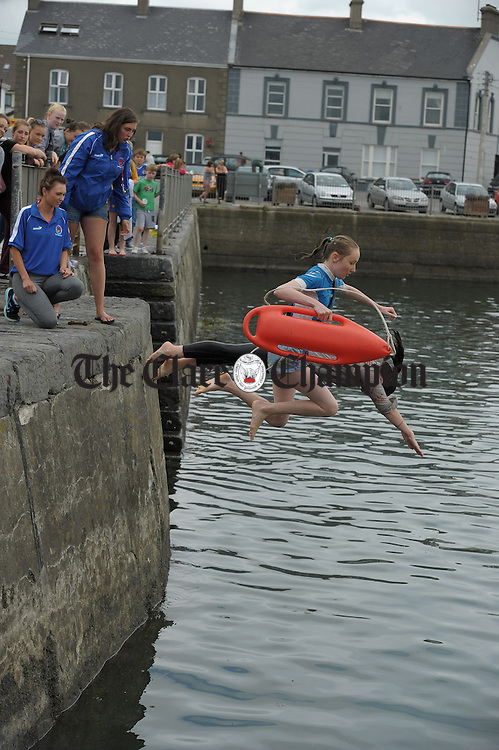 Instructors Leah Brew and Edel Broderick look on as Rescue 4 Award participants take to the water as part of their lifesaving and Water Safety classes at Cappa, Kilrush, run by the Clare Water Safety Association. Photograph by John Kelly.