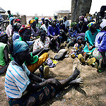 Women from the Nabule camp (NE Ghana) meet with their leader (usually the oldest woman living in the camp) to collect their food, which has been brought by a few of the catholic sisters. Only 30 woment are living in this isolated camp.