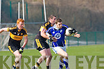 David Moran Kerins O'Rahillys is tackled by James Cahillane Dr Crokes in the Divison 1 league final in Killarney on Sunday