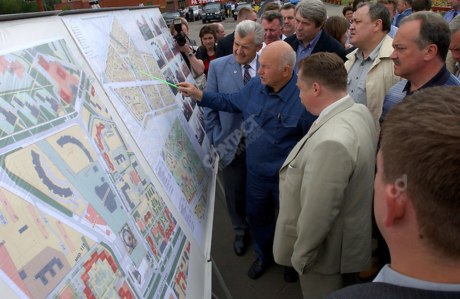 "Yuri Luzhkov, the Mayor of Moscow, meets with WWII veterans at a ceremony to dedicate a fountain and renamed a square ""Victory Square"" in honor of the 60th anniversary of the end of the war. Moscow, Russia, June 18, 2005"
