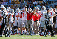Ohio State Buckeyes defensive backs coach Kerry Combs reacts after Ohio State Buckeyes linebacker Ryan Shazier (10) forces a fumble that Ohio State Buckeyes recover in the first quarter of the NCAA football game at Memorial Stadium in Berkeley, California,  Saturday afternoon, September 14, 2013. The Ohio State Buckeyes defeated the California Golden Bears 52 - 34. (The Columbus Dispatch / Eamon Queeney)