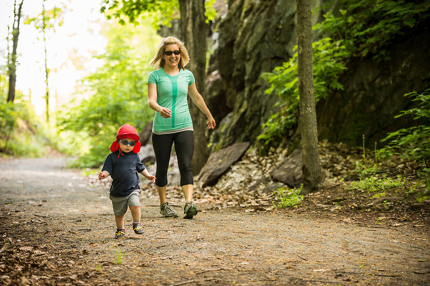 A young family explores the Iron Ore Heritage Trail at the Jackson Mine site in Negaunee, Michigan.