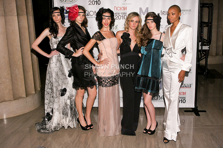 Fashion designer Stella Simona poses with models infront of backdrop during Nolcha Fashion Week, September 14, 2010.