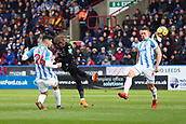 17th March 2018, The John Smiths Stadium, Huddersfield, England; EPL Premier League football, Huddersfield Town versus Crystal Palace; Wilfried Zaha of Crystal Palace fires in a shot but it was deflected by Christopher Schindler of Huddersfield Town with Jonathan Hogg of Huddersfield Town close by