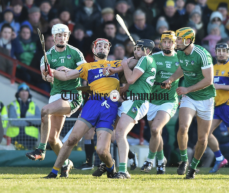 Peter Duggan of  Clare  in action against Kyle Hayes and Pat Ryan of  Limerick during their NHL quarter final at the Gaelic Grounds. Photograph by John Kelly.