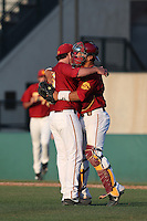 Kyle Davis #6 of the Southern California Trojans hugs catcher Jeremy Martinez #2 after a win against the Oregon State Beavers at Dedeaux Field on May 23, 2014 in Los Angeles, California. Southern California defeated Oregon State, 4-2. (Larry Goren/Four Seam Images)