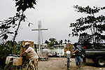 """The Monument for the Dead and Disappeared Migrant stands above the Suchiate River and the hustle and bustle of a day's work. The 'frontera' isn't the river,"""" says Father Barilli, of Casa del Migrants, or House of Migrants. """"Mexico is the 'frontera.'"""" Many migrants face a dangerous and deadly 1,500 mile journey to the United States loosing life or limb to gangs or trains."""