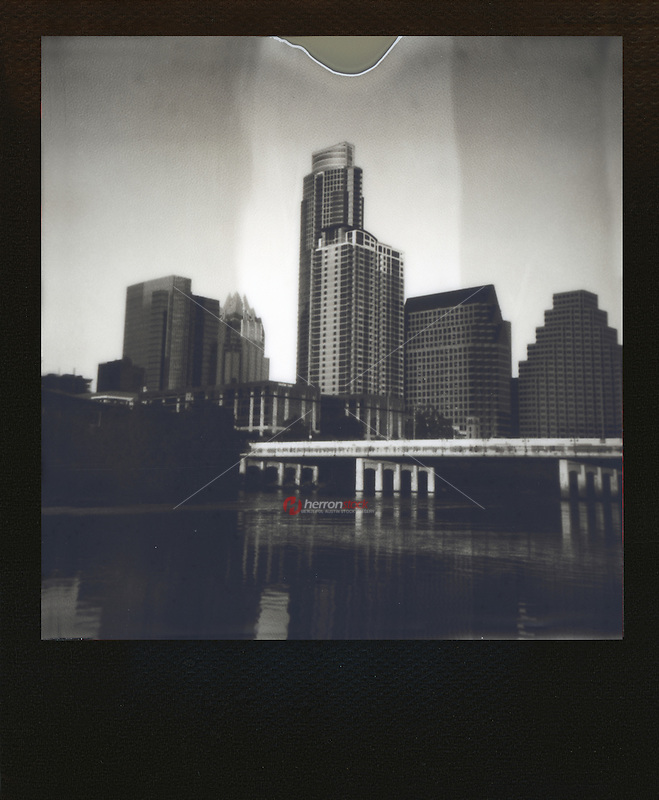 Polaroid instant film black and white picture of the downtown Austin Skyline - Stock Image.